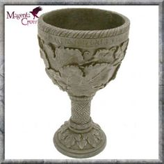 CELTIC GREETING PAGAN GOBLET. This beautiful cast resin Pagan goblet is decorated with leaves giving it an Autumn feel, it also has ancient writings along the rim and Celtic pattern on the stem. Size; 18cm high. The ideal Pagan gift or Alter accessory.