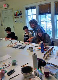 Artist Diane Dyal instructing the folks at LeMoyne's Mini Paint Your Pet workshop.