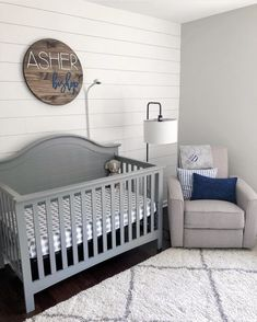 It's shiplap galore in this nursery - the perfect blend between rustic and contemporary. The Carter's by DaVinci Nolan Convertible Crib is a beautiful classic americana crib that easily fits into any nursery. Baby Boy Rooms, Baby Boy Nurseries, Nursery Decor Boy, Baby Boy Bedroom Ideas, Baby Nursery Ideas For Boy, Boy Decor, Nursery Ideas Neutral, Baby Room Decor For Boys, Baby Bedroom Ideas Neutral
