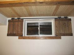 Unfinished Basement Ideas - Barn door shutters for the basement windows: added security, too (I prefer the Z style doors to the ones in this photo) Basement House, Basement Bedrooms, Basement Flooring, Basement Bathroom, Cozy Basement, Basement Office, Curtains For Basement Windows, Basement Walls, Basement Window Coverings