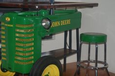 Vintage farm tractors reclaimed and repuposed into a bar       This is a very rare Tractor !!!