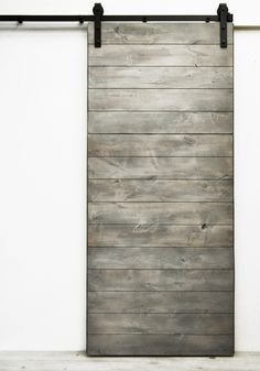 "Simple modern design at its best, the horizontal direction of the solid wood boards creates elegant visual flow. Standard door sizes are 82""H x 36""W and the larger 96""H x 48""W. Our collection of Dogbe"