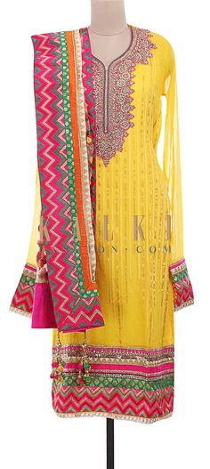 Buy Online from the link below. We ship worldwide (Free Shipping over US$100) http://www.kalkifashion.com/yellow-semi-stitched-suit-embellished-in-patchwork-and-gotta-patti-lace-only-on-kalki.html