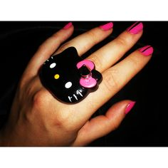 Hello Kitty ring in black ❤ liked on Polyvore