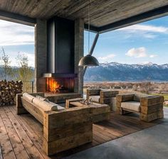Love the rustic feel of this outdoor fireplace area.