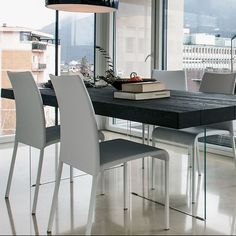 The Wildwood Air Table from LAGO juxtaposes the alluring natural oak grain with a transparent crystal quality of tempered glass legs. http://www.yliving.com/lago-air-table-wildwood.html