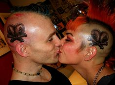 Helmets, nuts, and bolts! Our wedding tattoos. Punk love... SWADE ~Mohawk love. Tattoo, red, punk, goth, industrial, hair, makeup. Artist: Barnaby Williams.