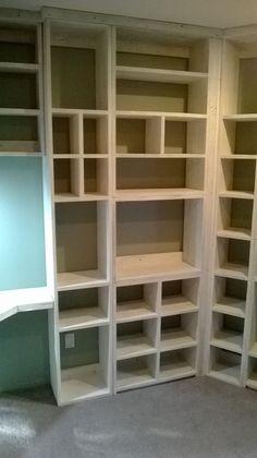 Floor to ceiling shelves around 3 bedroom walls