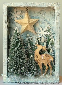 Layers of ink: Snowy Woods Tutorial for a winter scene in a shadow box, made with Sizzix Tim Holtz dies and trees.