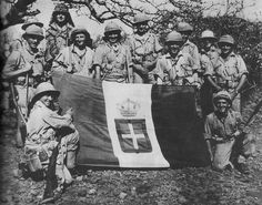East African Campaign, 1940-41: South African troops display captured Italian fascist flag. The campaign ended with the thorough defeat of the Italians.