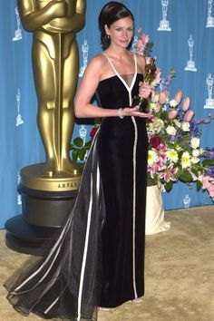 <p>2001 was a year of firsts for Roberts. She didn't just pick up her first Oscar for <em>Erin Brockovich</em> but she also was the catalyst to a new era of red carpet fashion- vintage couture. Her black 1982 Valentino gown with white ribbons and piping has a timeless beauty that is fabulous in any decade. Valentino himself has been recorded saying seeing Roberts in the dress was a highlight of his career.</p>