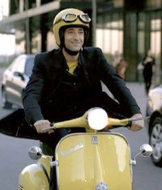 Adrian Brody and a yellow creme Vespa