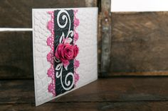 White pleather textured invitation with hot pink lace and 3D rose with white flourishes