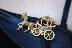 Horse and Carriage Brooch by DeadGirlsVintage on Etsy https://www.etsy.com/listing/244470719/horse-and-carriage-brooch