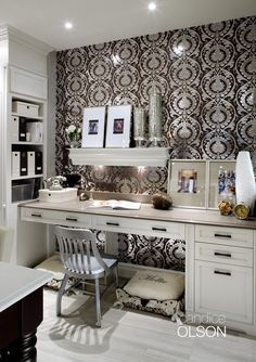 KITCHEN DESK: This desk wall is the first thing you see when you enter this kitchen, so it had to be a showstopper.  The large-scale wallpaper printed on silver foil creates a dramatic impact. Halogen lights mounted under the wall shelf illuminates the desk surface, while recessed ceiling fixtures provide general lighting. My favorite part of this kitchen office? Two stylish doggie beds that fit snuggly under the desk. #candiceolson #yorkwall
