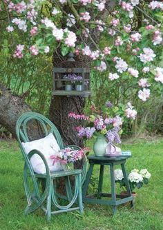 Painted furniture under an apple tree.