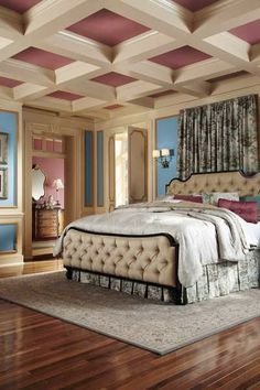 Panels of saturated royal blue pop against a subdued dusty rose coffered ceiling in this bedroom fit for royalty. Shown here: Cloisonné Blue T14-14 from BEHR | Photo: Courtesy of BEHR | thisoldhouse.com