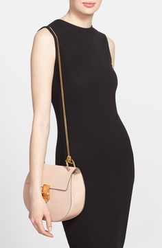 Free shipping and returns on Chloé Small Drew Leather Shoulder Bag at Nordstrom.com. Chloé's newest take on the saddle bag is the epitome of relaxed modernity: A rounded silhouette mixes with a squared-off flap, while gleaming goldtone hardware highlights the bag's soft, grained leather.
