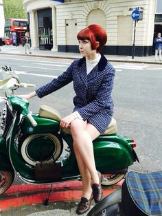 London mod girl.  Plain suit, loafers  a scooter.