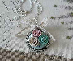 Necklace with fhand-made fimo roses.