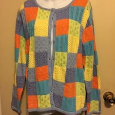Crystal Kobe. Color block sweater A sweater that buttons up front and solid color on back . Crystal Kole Sweaters