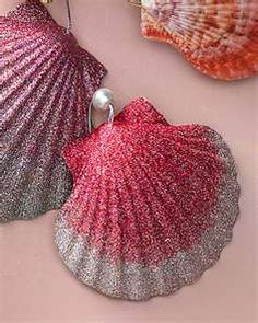 Seashells and glitter.... write on the inside of the shell with date/year. can use paint sharpie