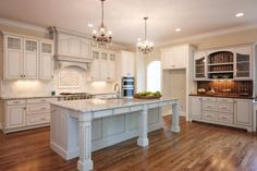 Washed white kitchen cabinets with matching island, extensive mouldings butler's pantry/bar - all custom made for this homeowner! Singleton Photograhy and Fiddle & Company builders #kitchen #cabinets #whitewash #island #woodwork #NC