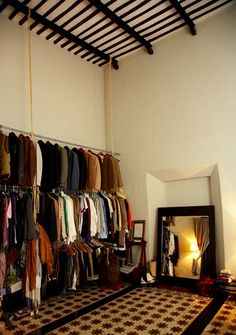 Somewhere I would like to live: Nicolas Malleville and Francesca Bonato 2 Story Closet, Makeshift Closet, Exposed Closet, Tulum Hotels, Hanging Bar, Out Of The Closet, Men Closet, Shop Interiors, Shop Interior Design