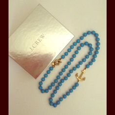 Nautical aquamarine necklace with gold anchor Bright turquoise beads with gold anchor. Comes with J. Crew gift box. Small scratch on one bead next to clasp, see last pic. J. Crew Jewelry Necklaces