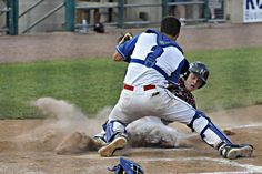 Nitro junior Eric Keller slides safely past Fairmont Senior senior catcher Tre Kerns as the Wildcats earned a 10-8 win in nine innings over the Polar Bears in the Class AAA semifinals on Thursday night at Appalachian Power Park.