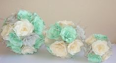 These Bouquets are made of mint green, silver and ivory handmade paper coffee filter Roses. The stems are wrapped in silver ribbon with rows of silver rhinestone mesh ribbon around the stems. Colors and design are customizable.