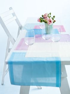 Colour your summer table with this sweet patchwork runner made from handkerchiefs. Choose colours that work well together and use iron-on webbing to adhere the napkins together. You can make a neat row or a staggered runner, as we've done.