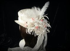 White brocade riding hat with pink accents. Top by TheTimeCabinet