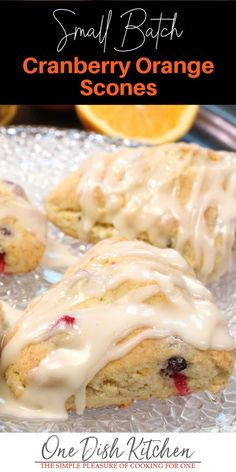 Buttery, melt-in-your-mouth Cranberry Orange Scones are perfect to enjoy with coffee or tea. This small batch recipe yields 4 perfect scones. | One Dish Kitchen