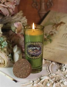 Absinthe scented candle includes fragrances of geranium, black currant, and basil fused with patchouli and tobacco.