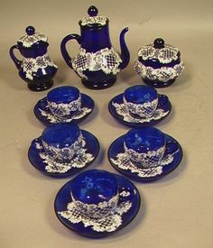 Antique Cobalt Glass Tea Set with hand painted lace pattern in white enamel.