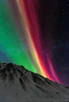 A spectacular aurora borealus if the colors haven't been tampered with.   Quite brilliant colors.