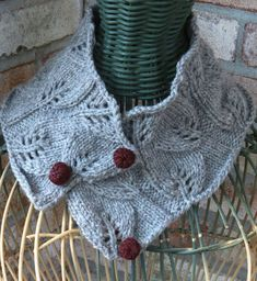 Free Knitting Pattern for Equinox Cowl - Neckwarmer knit with leaf lace with berry buttons. Aran weight yarn. Designed by Chris de Longpre