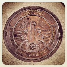 Art Deco sewer cover. Miami SouthBeach Iron MadeInUSA
