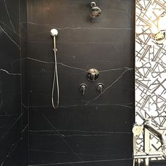 Black marble shower combined with black and white graphic tiles ...... I want this bathroom! Spotted at #kbis2016 at the #kallista booth . Design by #kellywearstler for #annsacks #blackandwhite #tile #marble #blackmarble #bathroom #shower #luxury #BlogTourKBIS #blogtour #modenus #designhounds #design #lasvegas #blogtourkbis #blogtourLasVegas #kitchen #bath #bathroom #luxury #luxurylifestyle #luxurytrend #bathroomtrends #kitchentrends