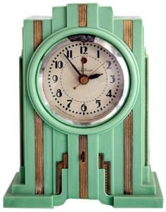 "Telechron American Art Deco Skyscraper Clock in Mint Green Produced from about 1929 till 1931 this skyscraper styled American art deco table clock was made by the Warren Telechron Company. Known as the Model 700 and marketed as the ""Electrolarm"", the clock came in three colours; walnut (brown Bakelite) and white or green ""Vinylite"" (Plaskon). Brown colours are the most common, green the rarest"