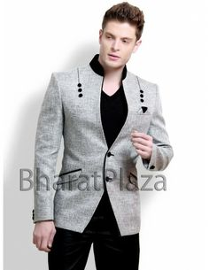 Opulence Look Grey Blazer Item code : TSJL1107G http://www.bharatplaza.in/mens-wear/mens-designer-suits/jodhpuri-suits/opulence-look-grey-blazer-tsjl1107g.html Opulence look grey color blazer is invented on jute fabric. Wonderful piping pattern with attractive buttons, velvet patch high neck collar and flap pocket is very well compliment to it. Paired with black trouser. Make your celebration come alive with this stunning outfit.