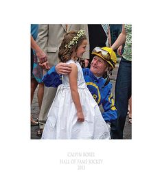 """Calvin Borel - Hall of Fame Jockey"" Taken after the first race on the first day of racing at Churchill Downs in the 2010 Spring Meet, Hall of Fame Jockey, Calvin Borel celebrates in the winner's circle with a young girl in her First Communion dress.   The following week, Borel rode Super Saver to victory in the Kentucky Derby making him the first jockey to win three Derbies in four years.  Lots of firsts here including my first winner's circle image."