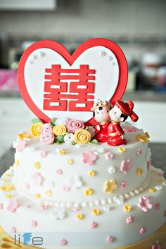 Cute Chinese wedding cake  - heart with the double happiness, some flowers and then our ladybugs sitting to the side?