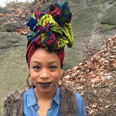A traditional African double-sided headwrap bound to make heads turn. Wash cold with similar colors. Hang to dry. 72 in x 22 in. All cotton. Headwraps are handmade and sizes may vary slightly.