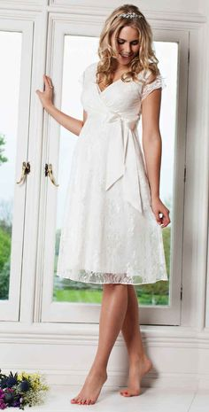 And this delicate lace dress. | 13 Gorgeous Maternity Wedding Dresses For Under £200