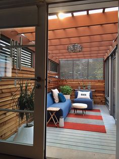 """Upstairs, what Santos calls a """"very, very raw"""" screen porch stood off the master bedroom; the couple enclosed it to accommodate a seating area overlooking an interior courtyard."""