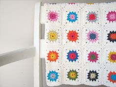 Granny Square afghan - love how the brights 'pop' against the white.  I'm thinking this would be a GREAT addition to E's room when we figure out new bedding (after she gets her new bed).