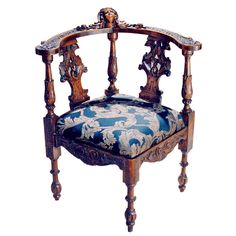 Baroque style elaborately carved walnut corner chair. With intricate detail - the chair splats with griffins; the arms and rail top with leaves and acorns and centered with a young cherub face carved into a shell; the apron with a swirl and leaf pattern - with the carved detail extending to the turned legs. England, 19th Century. - Linda Horn , New York