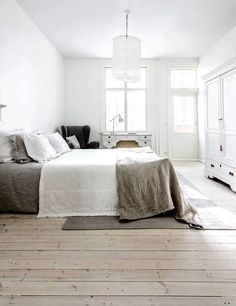 that hardwood floor and linen bedding.